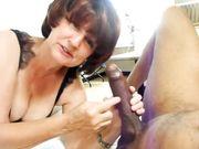 Horny granny sucking black dick